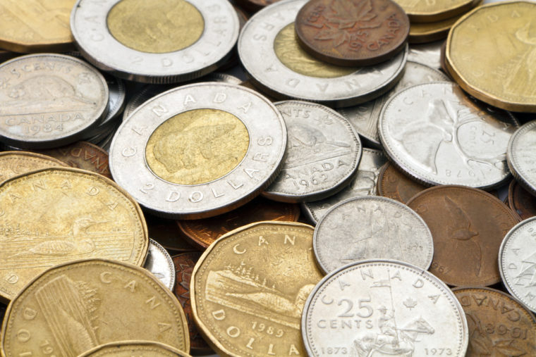 Columbia, South Carolina, USA - October, 12th 2011: A studio shot of a pile of current, modern day, legal tender Canadian coins.